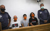 Brig. Gen. (Res.) Amir Haskel (C) and two other protesters at Jerusalem Magistrate's Court Hearing onJune 27, 2020, after they were arrested during a protest outside Prime Minister Benjamin Netanyahu's official Jerusalem residence. (Yonatan Sindel/Flash90)