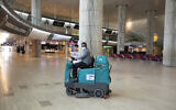An airport staff cleaner in the empty arrivals hall at Ben Gurion International Airport on June 12, 2020 (Olivier Fitoussi/Flash90)
