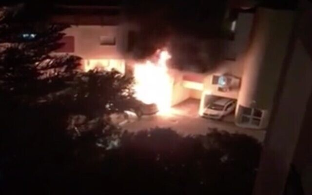 Screen capture from video of a fire at the home of a firefighter in Migdal Haemek, June 22, 2002. (Channel 13)