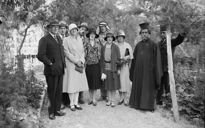 British high commissioner John Chancellor, far left, with princess Illeana of Romania and other personages in his garden, circa 1930. (Public domain)