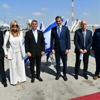Foreign Minister Gabi Ashkenazi (3L) greeting a Greek delegation led by Prime Minister Kyriakos Mitsotakis (3R) at Ben Gurion Airport, June 16, 2020. (Shlomi Amsalem/Foreign Ministry)