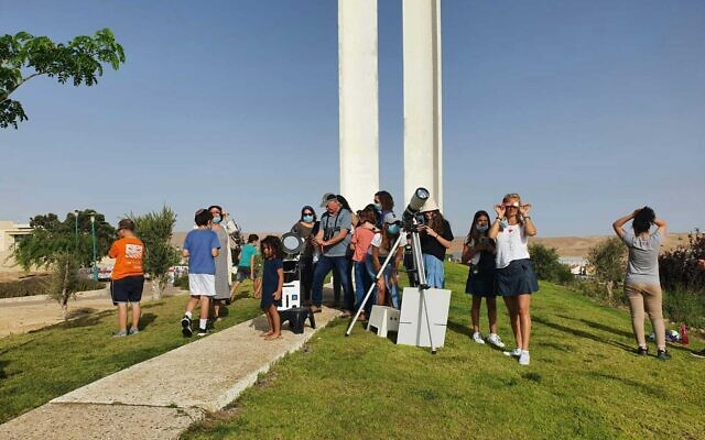 Israelis gather in Yeruham to watch a solar eclipse, June 21, 2020. (Moshe Glantz)