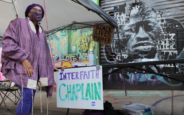 Social worker and health care chaplain Chava Monastersky staffs the interfaith chaplaincy at the Capitol Hill Occupied Protest in Seattle. (Gregory Gutterman Scruggs/Times of Israel)