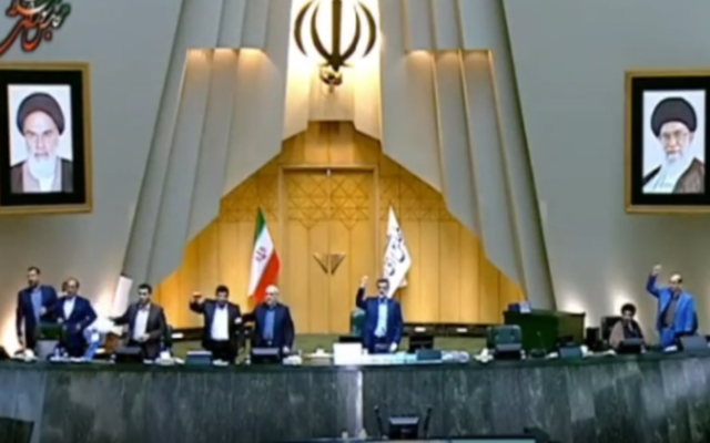 "Iranian lawmakers chant ""death to America"" in an alleged show of support for US protesters demonstrating against George Floyd's killing by a police officer, at the Iranian parliament in the capital Tehran, June 7, 2020. (Screen capture: Instagram)"