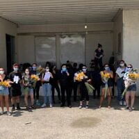 Illustrative: Masa Israel fellows deliver flowers to Holocaust survivors, (Courtesy via JTA)