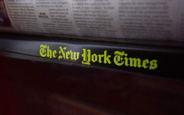 The New York Times logo is seen on a newspaper rack at a convenience store in Washington, DC, on August 6, 2019. (ALASTAIR PIKE/AFP via Getty Images and JTA)