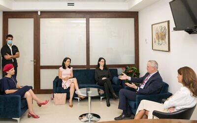 Blue and White Party leader Defense Minister Benny Gantz, second right, meets with incoming lawmakers set to enter the Knesset under the so-called Norwegian Law, June 17, 2020. (Noam Moskowitz)