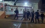 Video aired by the Kan public broadcaster on June 4, 2020, shows police arresting a suspect in connection to the assault on former Likud MK Yehudah Glick in East Jerusalem's Wadi al-Joz neighborhood. (Screen capture: Twitter)