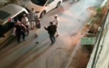 A Palestinian man is attacked by a group of Israelis in the West Bank city of Hebron on June 13, 2020. (Screen capture: Twitter)
