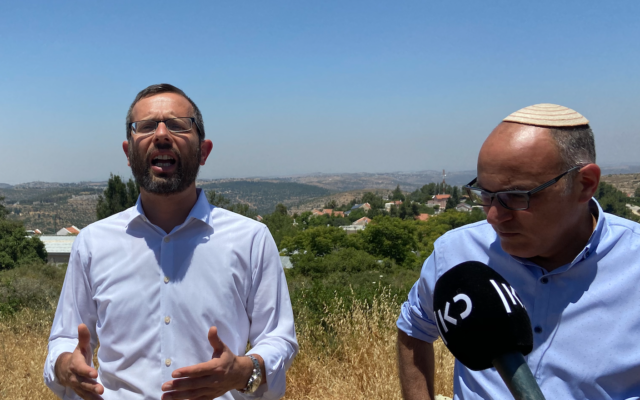 Binyamin Regional Council chairman Yisrael Gantz (left) and Yesha Council director Yigal Dilmoni speak to reporters in the Ateret settlement on June 16, 2020. (Jacob Magid/Times of Israel)