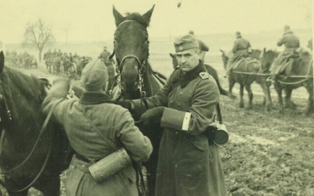 Robert Griesinger (right) in Wehrmacht uniform with one of the horses from the 25th Infantry Division c. 1939 (Courtesy of Jutta Mangold)