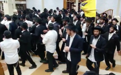 Worshipers dance at the Chabad synagogue at 770 Eastern Parkway in Brooklyn, June 22, 2020. (Screenshot from video via JTA)