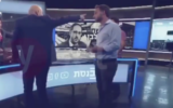 Screen capture from video of MK Ofer Shelah, Yesh Atid-Telem, left, with his back to the camera during an altercation while he was giving an interview to the Knesset Channel, May 2020. (Ynet)