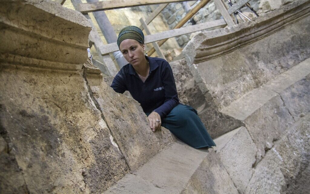 Tehillah Liberman at an unfinished, 2nd-century CE Roman theater. (Yaniv Berman/Israel Antiquities Authority)