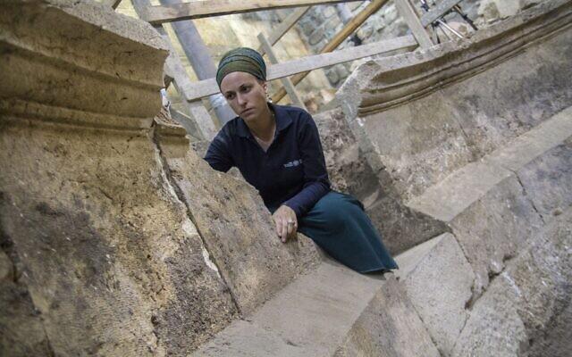 Tehillah Liberman at an unfinished, 2nd-century CE Roman theater. (Yaniv Berman/Israel Antiquities Authority)