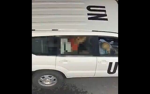 A woman straddles a man in the back of a United Nations vehicle in a video clip that was shared widely online on June 26, 2020. The video is believed to be from Tel Aviv and the image has been pixelated by the Times of Israel. (Screenshot/Twitter)
