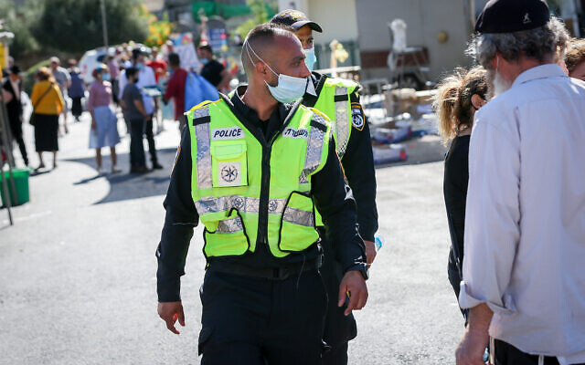 Israelis wear protective face masks as they shop for food at the local market in Tzfat, northern Israel, June 24, 2020. (David Cohen/Flash90)