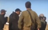 IDF officers confronted by a Bedouin crowd at the entrance to the town of Bir Hadaj in the Negev Desert, May 31, 2020. (Screenshot: YouTube)
