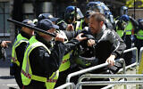 Police apprehend a protester in Whitehall near Parliament Square, London, during a protest by the Democratic Football Lads Alliance against a Black Lives Matter protest, June 13, 2020. (Jonathan Brady/PA via AP)