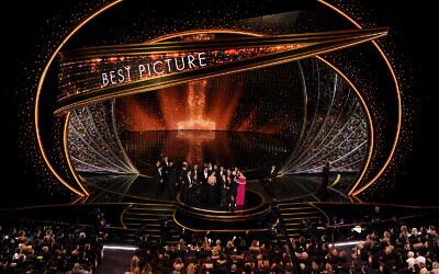 """The cast and crew of """"Parasite"""" accept the award for best picture at the Oscars, February 9, 2020, at the Dolby Theatre in Los Angeles. (AP Photo/Chris Pizzello)"""