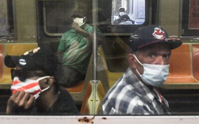 People ride the subway in Brooklyn, New York, June 8, 2020. (Stephanie Keith/Getty Images/AFP)
