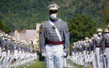 United States Military Academy graduating cadets wear face masks as they stand next to their socially-distanced seats during commencement ceremonies in West Point, New York, June 13, 2020. (AP/John Minchillo, Pool)