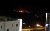 An explosion is seen in the night sky near Tehran in a video posted online by the country's Fars news agency, June 26, 2020. (Screenshot/Twitter)