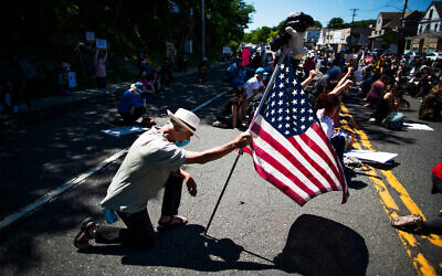 Demonstrators kneel during a solidarity protest for George Floyd in West Point, New York, June 13, 2020. (AP/Eduardo Munoz Alvarez)
