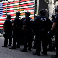 Police officers in riot gear stand by in Times Square during a protest in Manhattan in New York, June 1, 2020. (AP/Seth Wenig)