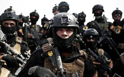 Soldiers from Iraq's Counter-Terrorism Service listen to an address by a commander after a training exercise in Baghdad, Iraq, August 13, 2016. (AP Photo/Maya Alleruzzo, File)