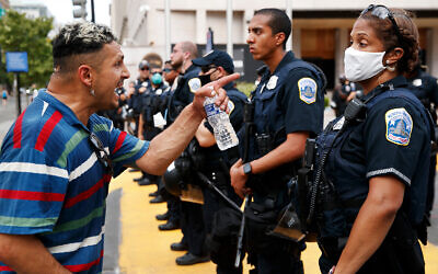 A man yells at police as demonstrators protest in support of the Black Lives Matter movement in Washington, DC, June 23, 2020. (AP Photo/Jacquelyn Martin)