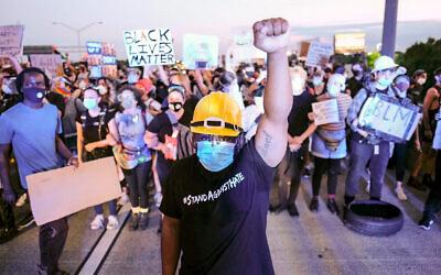 Demonstrators shut down an interstate after the police shooting of Rayshard Brooks in Atlanta, Georgia, June 13, 2020. (Ben Gray/Atlanta Journal-Constitution via AP)