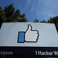 The thumbs up 'Like' logo on a sign at Facebook headquarters in Menlo Park, California, April 14, 2020. (AP/Jeff Chiu)