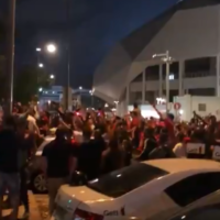 Hundreds of fans of soccer club Hapoel Tel Aviv celebrating a win outside Bloomfield Stadium in Tel Aviv on June 2, 2020, without adhering to social distancing rules. (Screenshot: Twitter)