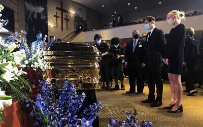 Minneapolis Mayor Jacob Frey, second from right, and First Lady Sarah Clarke, right, pause before George Floyd's casket, June 4, 2020, before a memorial service for Floyd in Minneapolis. (AP/Bebeto Matthews)
