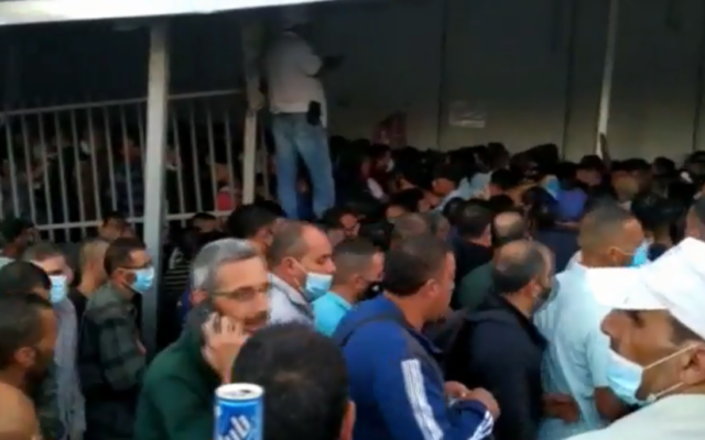 Palestinian workers on their way to work in Israel, at Bethlehem's Checkpoint 300 in the West Bank, June 2020. (Screenshot: Channel 12)