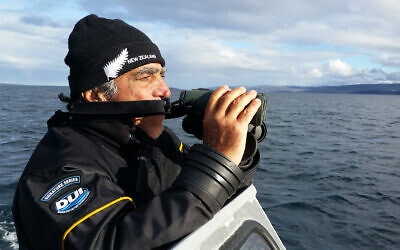 "Amos Nachoum searches for polar bears in the Canadian Arctic. (Screenshot/""Picture of his Life"" via JTA)"