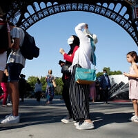 People line up to visit the Eiffel Tower, in Paris, June 25, 2020. (AP Photo/Thibault Camus)
