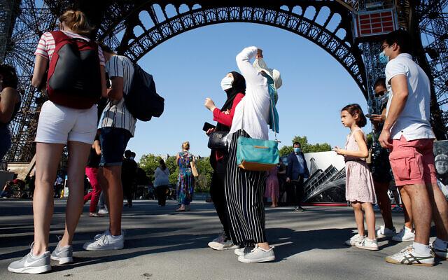 People line up to visit the Eiffel Tower, in Paris, June 25, 2020. (AP Photo/Thibault Camus)