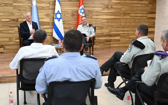 Defense Minister Benny Gantz, left, and IDF Chief of Staff Aviv Kohavi, right, meet with the IDF General Staff in the military's Kirya headquarters in Tel Aviv on May 18, 2020. (Ariel Hermoni/ Defense Ministry)