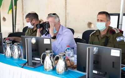 Defense Minister Benny Gantz, center, surveys the northern border with IDF Chief of Staff Aviv Kohavi, right, in northern Israel on June 2, 2020. (Israel Defense Forces)