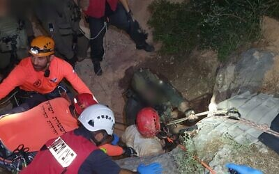 Police and rescue workers extract three men who got stuck in a cave near the Galilee town of Iksal while searching for treasure, June 6, 2020. (Israel Police)