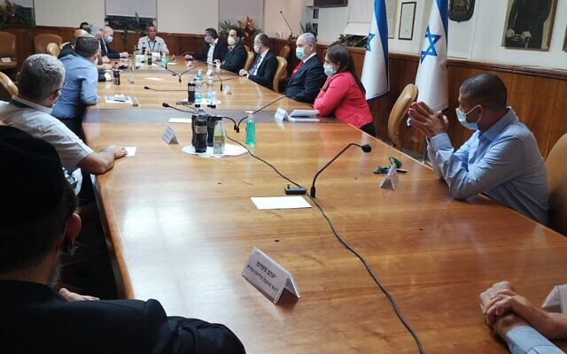 Prime Minister Benjamin Netanyahu (red tie) and Settlements Minister Tzipi Hotovely (red blouse) meet with settler leaders in the Prime Minister's Office on June 7, 2020. (Courtesy)