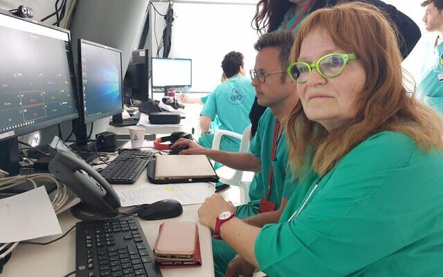Prof. Galia Rahav, Head of Sheba Medical Center's Infectious Disease Unit and Laboratory, looks at data on COVID-19 patients (courtesy of Sheba Medical Center)