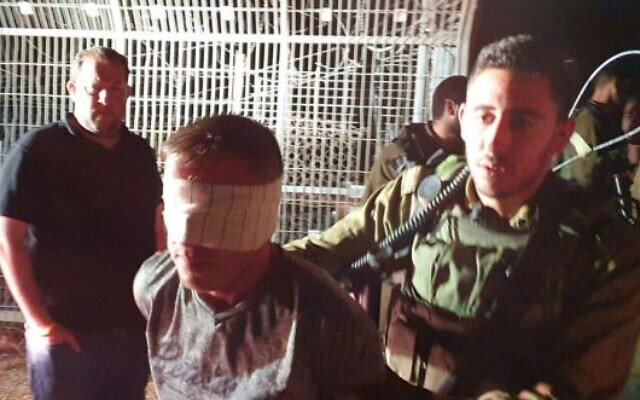 IDF soldiers detain a Palestinian caught trying to infiltrate Itamar settlement with a knife on June 9, 2020. (Roy Hadi/Samaria Regional Council)