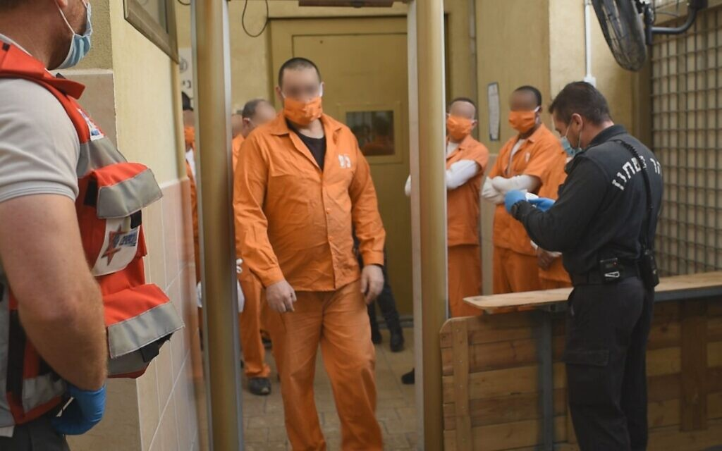 Prisoners in Rimonim maximum security prison wear masks to prevent the spread of COVID-19 among the prison population. (Courtesy Israel Prison Service)