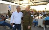 Head of the IDF Northern Command Amir Baram (right) and the former deputy commander of the IDF's Lebanon Liaison Unit Shaul Kamisa Raz take part in a ceremony marking the cooperation between the IDF and South Lebanon Army during Israel's 18-year occupation of Lebanon, on June 9, 2020. (Israel Defense Forces)