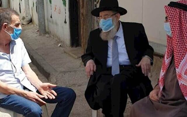 Jerusalem Chief Rabbi Aryeh Stern, center, speaking to members of Iyad Halak's family during a condolence call on June 2, 2020. (Courtesy)