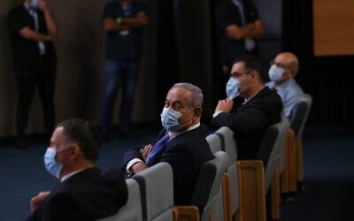 Prime Minister Benjamin Netanyahu (center) attends a ceremony welcoming the new Health Ministry director general, in Jerusalem on June 18, 2020 (Health Ministry)