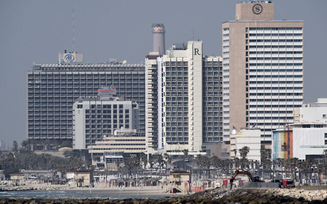 Hotels on Tel Aviv's coastline are seen from Jaffa on March 26, 2020 (Gili Yaari /Flash90)